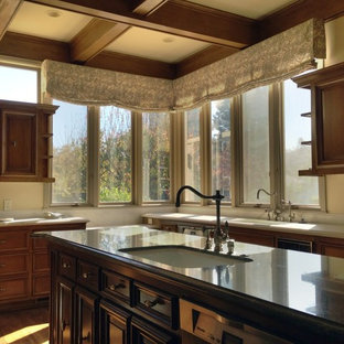 Large traditional eat-in kitchen remodeling - Eat-in kitchen - large traditional l-shaped medium tone wood floor eat-in kitchen idea in San Francisco with an undermount sink, raised-panel cabinets, medium tone wood cabinets, granite countertops, stainless steel appliances and an island