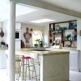 Vintage l-shaped kitchen in London with open cabinets, dark wood cabinets, white appliances, painted wood flooring and an island.