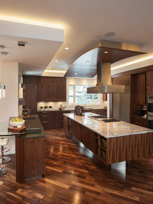 Superior Inspiration For A Contemporary Brown Floor Kitchen Remodel In Calgary With  Stainless Steel Appliances, Flat