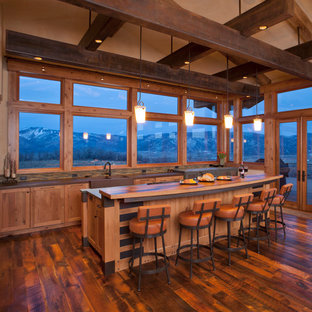 Inspiration for a country l-shaped eat-in kitchen in Denver with an integrated sink, medium wood cabinets, wood benchtops, multi-coloured splashback, with island, brown benchtop, shaker cabinets, matchstick tile splashback, stainless steel appliances, dark hardwood floors and brown floor.