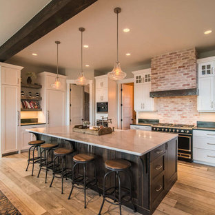 Rustic kitchen appliance - Example of a mountain style kitchen design in Atlanta