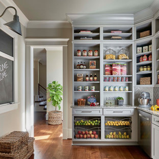 Rustic l-shaped kitchen pantry in Raleigh with a submerged sink, open cabinets, grey cabinets, grey splashback, stainless steel appliances, medium hardwood flooring and multicoloured worktops.