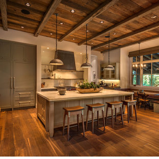 Large rustic eat-in kitchen ideas - Large mountain style u-shaped medium tone wood floor eat-in kitchen photo in San Francisco with gray cabinets, white backsplash, ceramic backsplash, paneled appliances, an island, beaded inset cabinets, marble countertops and a farmhouse sink