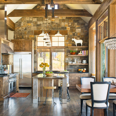 Inspiration for a rustic l-shaped dark wood floor and brown floor eat-in kitchen remodel in Denver with recessed-panel cabinets, medium tone wood cabinets, gray backsplash, stone tile backsplash, stainless steel appliances, an island and black countertops