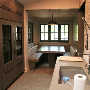 Inspiration for a mid-sized modern l-shaped open plan kitchen in Denver with an undermount sink, flat-panel cabinets, with island, brown cabinets, zinc benchtops, grey splashback, porcelain splashback, stainless steel appliances and light hardwood floors.