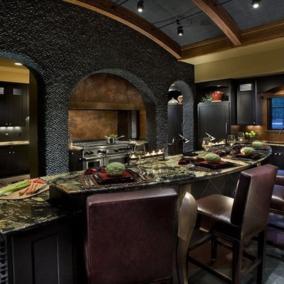 Enclosed kitchen - large contemporary u-shaped ceramic tile enclosed kitchen idea in Phoenix with shaker cabinets, black cabinets, granite countertops, brown backsplash, ceramic backsplash, stainless steel appliances and an island