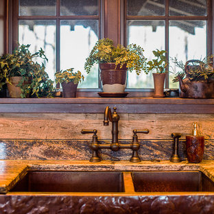 Large rustic open concept kitchen pictures - Large mountain style l-shaped medium tone wood floor open concept kitchen photo in Other with a farmhouse sink, recessed-panel cabinets, medium tone wood cabinets, granite countertops, beige backsplash, stone slab backsplash and paneled appliances