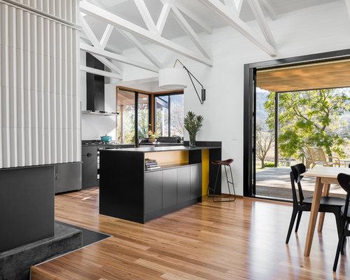 Large Midcentury Eat In Kitchen With Medium Hardwood Floors, Flat Panel  Cabinets,