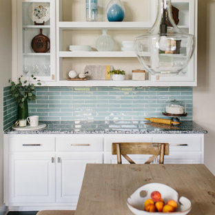 Mid-sized contemporary enclosed kitchen ideas - Inspiration for a mid-sized contemporary u-shaped dark wood floor enclosed kitchen remodel in Austin with an undermount sink, shaker cabinets, white cabinets, granite countertops, cement tile backsplash, stainless steel appliances, an island and gray countertops