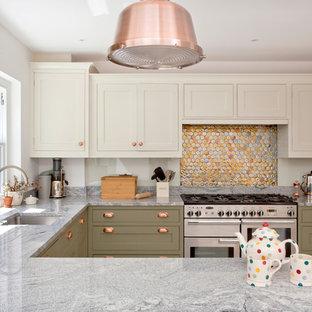 Transitional kitchen ideas - Kitchen - transitional u-shaped kitchen idea in London with an undermount sink, shaker cabinets, green cabinets, metallic backsplash, mosaic tile backsplash, stainless steel appliances and a peninsula
