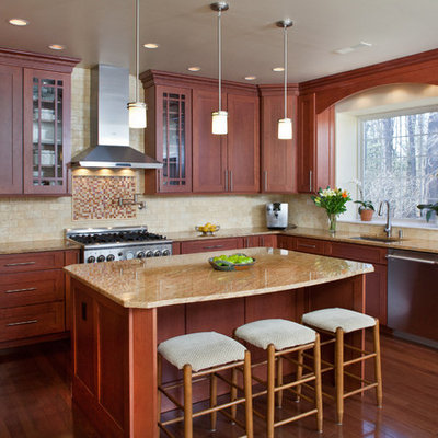 Kitchen - traditional kitchen idea in Philadelphia with shaker cabinets, medium tone wood cabinets, beige backsplash and stainless steel appliances