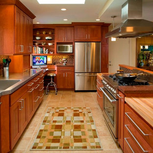Photo of a contemporary kitchen in Portland with mosaic tile splashback, stainless steel appliances, an integrated sink, dark wood cabinets, stainless steel benchtops, brown splashback and shaker cabinets.