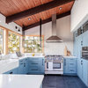 A Kitchen With Unexpected Blue Cabinets, Nice Storage and Views