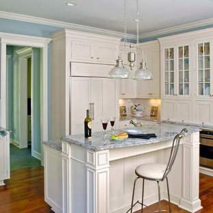 Multi Level White Cabinet Breakfast Island with Ice Blue Countertops