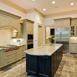 Mid-sized traditional kitchen pantry photos - Mid-sized elegant u-shaped limestone floor kitchen pantry photo in Orlando with a farmhouse sink, raised-panel cabinets, quartzite countertops, beige backsplash, ceramic backsplash, stainless steel appliances and an island