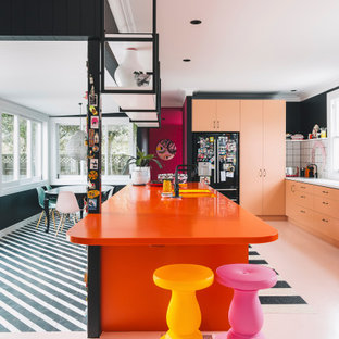 Contemporary kitchen in Other with an undermount sink, laminate benchtops, white splashback, ceramic splashback, black appliances, painted wood floors, with island, pink floor and orange benchtop.