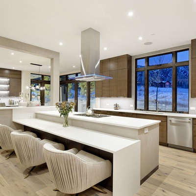 Inspiration for a large contemporary u-shaped light wood floor and beige floor eat-in kitchen remodel in Denver with flat-panel cabinets, dark wood cabinets, an undermount sink, window backsplash, stainless steel appliances, quartzite countertops, gray backsplash, an island and white countertops
