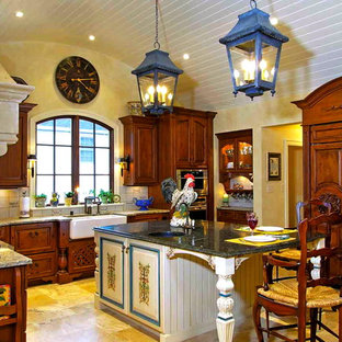 Enclosed kitchen - mid-sized french country l-shaped travertine floor enclosed kitchen idea in Louisville with a farmhouse sink, raised-panel cabinets, medium tone wood cabinets, granite countertops, white backsplash, ceramic backsplash, stainless steel appliances and an island