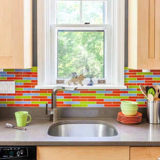 Inspiration for a small eclectic galley separate kitchen in Philadelphia with an undermount sink, shaker cabinets, light wood cabinets, quartz benchtops, multi-coloured splashback, glass tile splashback, stainless steel appliances, ceramic floors and no island.