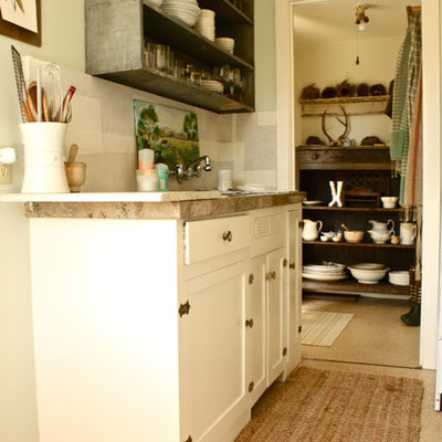 Kitchen - traditional kitchen idea in San Francisco with open cabinets