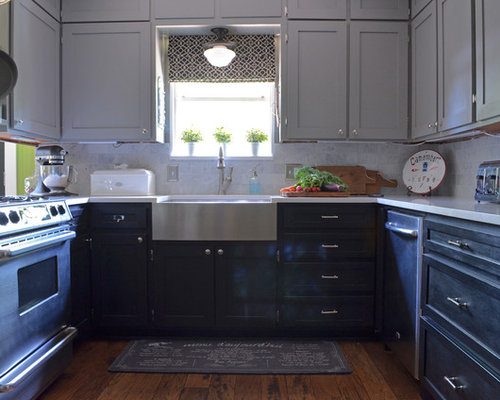 Example Of A Classic U Shaped Enclosed Kitchen Design In Austin With A  Farmhouse Sink