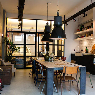 Example of an eclectic single-wall eat-in kitchen design in Amsterdam with a farmhouse sink, open cabinets, white cabinets, white backsplash, subway tile backsplash and black appliances