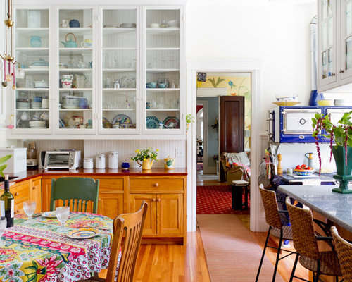 Example Of An Eclectic Eat In Kitchen Design In Boston With Wood Countertops Glass