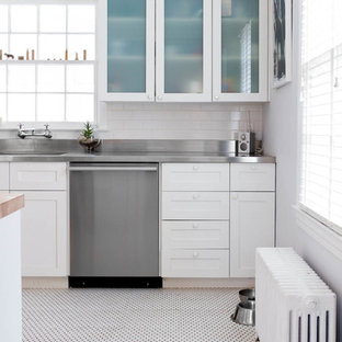 Inspiration for a contemporary white floor kitchen remodel in New York with stainless steel countertops and an integrated sink