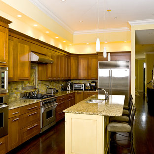 Example of a classic kitchen design in Chicago with stainless steel appliances and slate backsplash