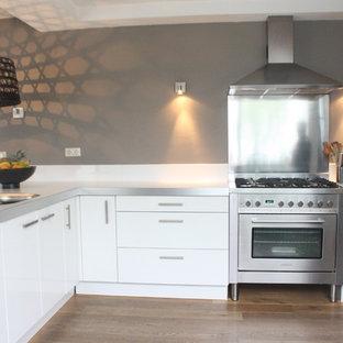 Contemporary kitchen photos - Trendy kitchen photo in Amsterdam