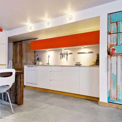 Trendy kitchen photo in Toronto with concrete countertops and white appliances