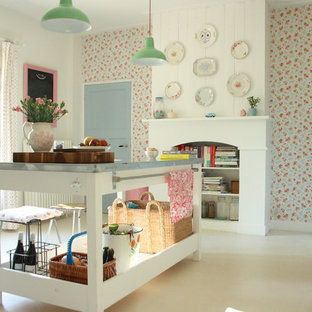 Design ideas for a shabby-chic style kitchen in Amsterdam with white cabinets, zinc benchtops and coloured appliances.