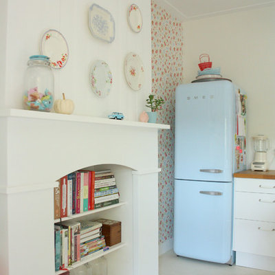 Kitchen - shabby-chic style kitchen idea in Amsterdam with white cabinets, wood countertops and colored appliances