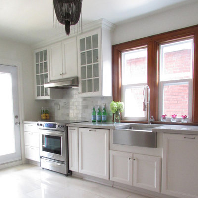 Kitchen - traditional white floor kitchen idea in Toronto with a farmhouse sink, recessed-panel cabinets, white cabinets and stainless steel appliances
