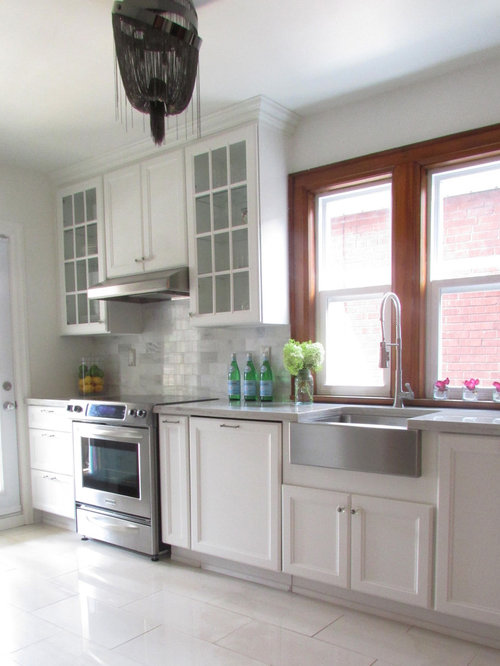Traditional White Floor Kitchen Idea In Toronto With A Farmhouse Sink,  Recessed Panel Cabinets
