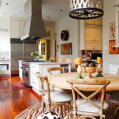 Inspiration for an eclectic eat-in kitchen remodel in New York with shaker cabinets, white cabinets and stainless steel appliances