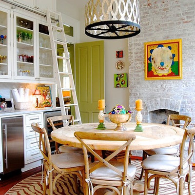 Eat-in kitchen - eclectic eat-in kitchen idea in New York with glass-front cabinets
