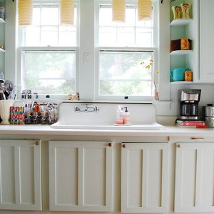 Kitchen - eclectic kitchen idea in New York with a drop-in sink, shaker cabinets, white cabinets and white backsplash