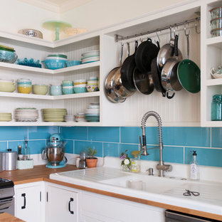 Mid-sized eclectic eat-in kitchen photos - Eat-in kitchen - mid-sized eclectic l-shaped eat-in kitchen idea in Columbus with a drop-in sink, open cabinets, white cabinets, wood countertops, blue backsplash, subway tile backsplash, stainless steel appliances and an island
