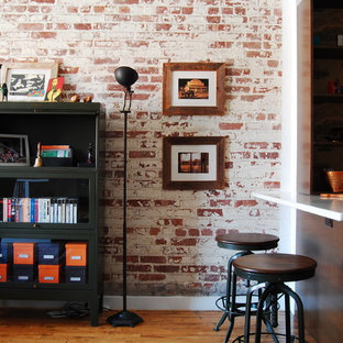 Industrial kitchen inspiration - Example of an urban kitchen design in New York with dark wood cabinets