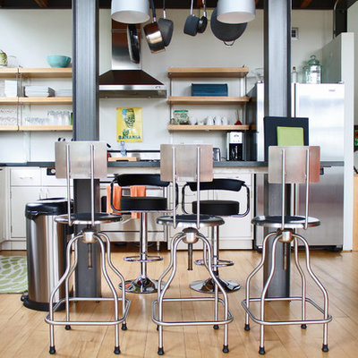 Trendy kitchen photo in Burlington with flat-panel cabinets