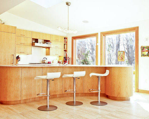 Contemporary Kitchen Idea In Boston With Flat Panel Cabinets, Medium Tone  Wood Cabinets And