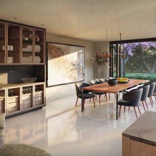 Inspiration för moderna svart kök, med en undermonterad diskho, släta luckor, skåp i mellenmörkt trä, bänkskiva i kalksten, svart stänkskydd, stänkskydd i kalk, integrerade vitvaror, terrazzogolv, en köksö och grått golv