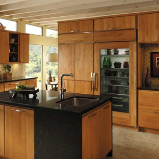 Photo of a large midcentury single-wall separate kitchen in Atlanta with an undermount sink, flat-panel cabinets, medium wood cabinets, quartz benchtops, multi-coloured splashback, mosaic tile splashback, stainless steel appliances, travertine floors, with island, beige floor and black benchtop.