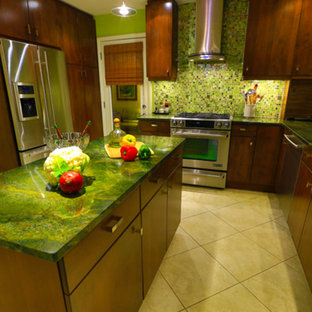 Photo of a mid-sized eclectic u-shaped kitchen in Other with an undermount sink, flat-panel cabinets, medium wood cabinets, green splashback, glass tile splashback, stainless steel appliances, ceramic floors, with island, beige floor and green benchtop.