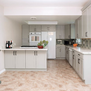 Inspiration for a small traditional l-shaped eat-in kitchen in Los Angeles with a drop-in sink, shaker cabinets, grey cabinets, quartz benchtops, blue splashback, cement tile splashback, white appliances, ceramic floors, no island and pink floor.
