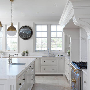Inspiration for a large traditional u-shaped open plan kitchen in Other with a drop-in sink, beaded inset cabinets, white cabinets, marble benchtops, white splashback, marble splashback, stainless steel appliances, porcelain floors, with island, beige floor and yellow benchtop.