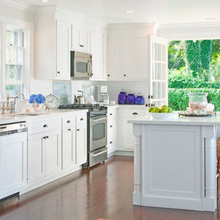 Kitchen - traditional kitchen idea in Boston with shaker cabinets and paneled appliances