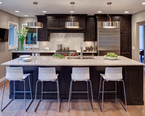 kitchens with dark cabinets and white countertops 1