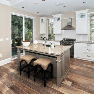 Inspiration for a timeless kitchen remodel in Miami with stainless steel appliances and white backsplash